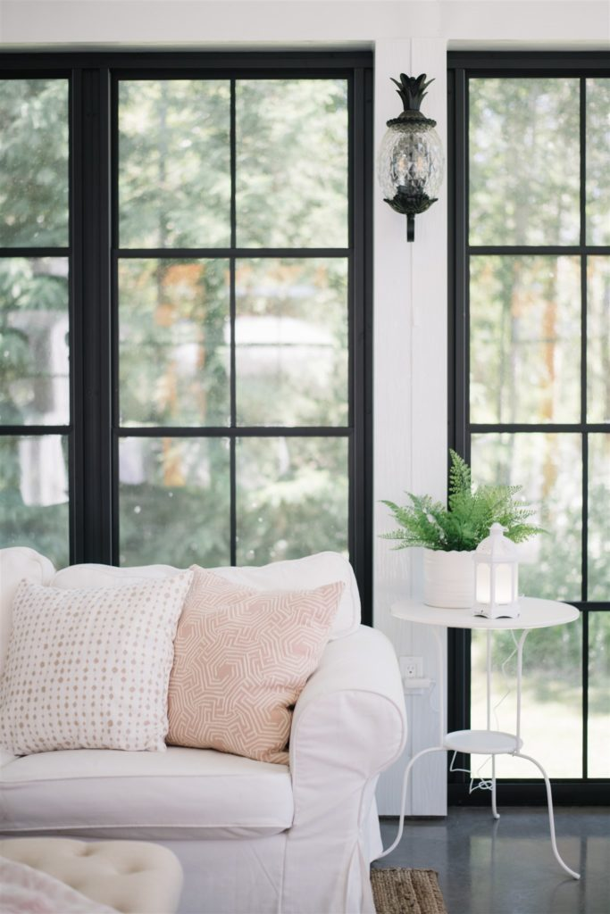 Simple summer setup with diffuser in screen room with black windows and white furniture!