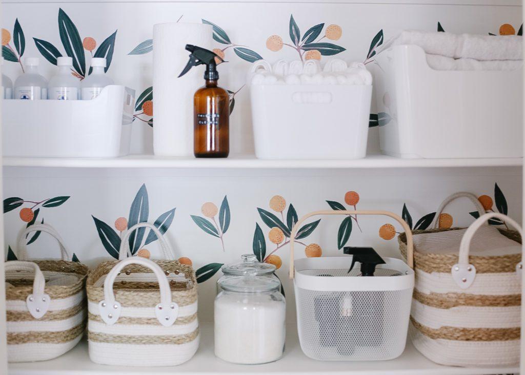Bins and baskets in an organized linen closet!