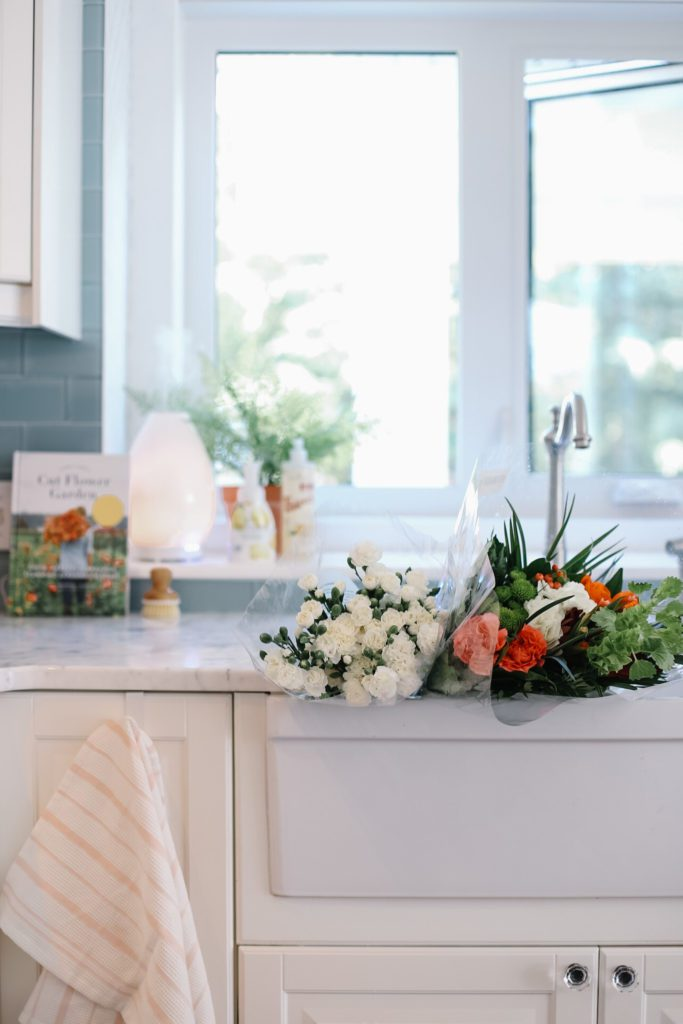 Grocery store flowers sitting in kitchen sink