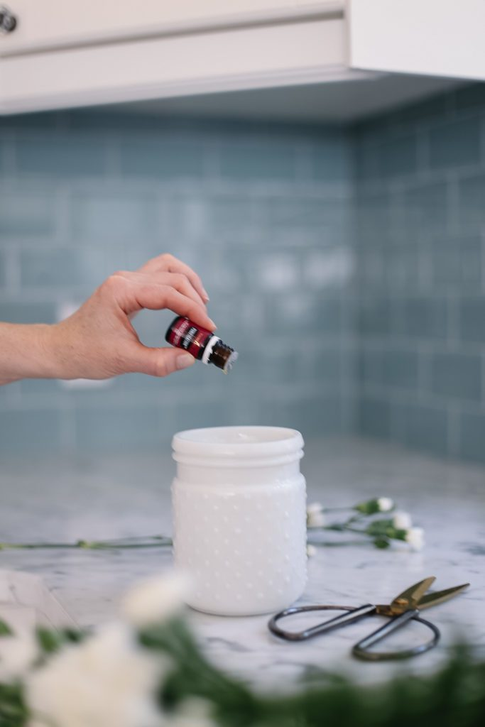 Adding Purification essential oil to the water of fresh cut flowers