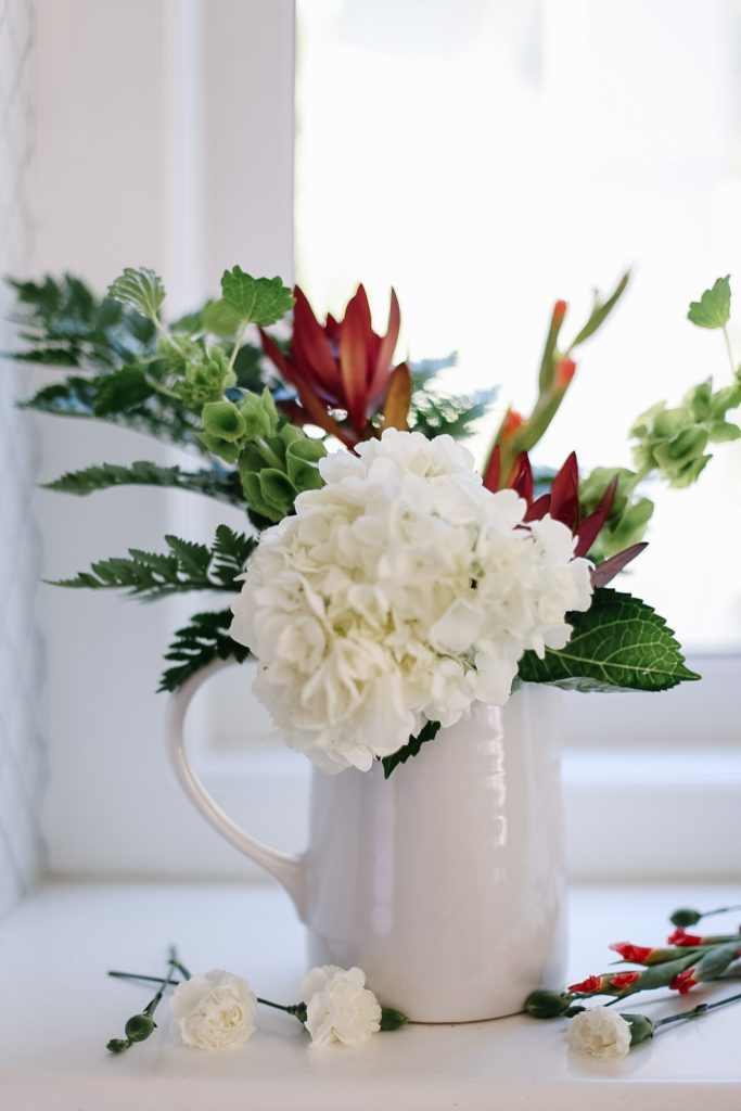 Grocery store flower arrangement with hydrangea in a vase
