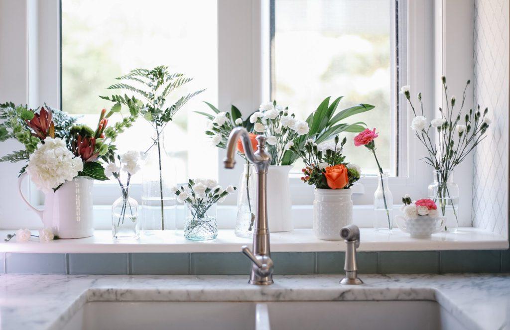 10 different flower arrangements on kitchen windowsill