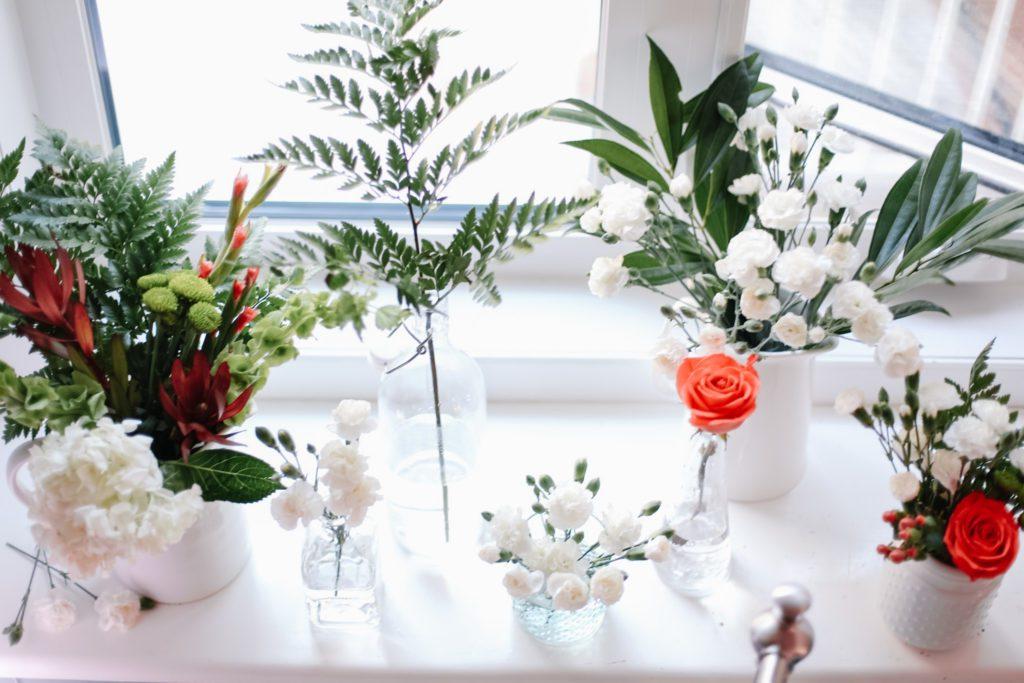 Flowers on kitchen window ledge