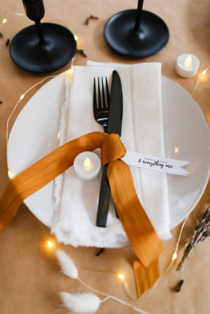 A simple Thanksgiving tablescape with gold ribbon and printable tags