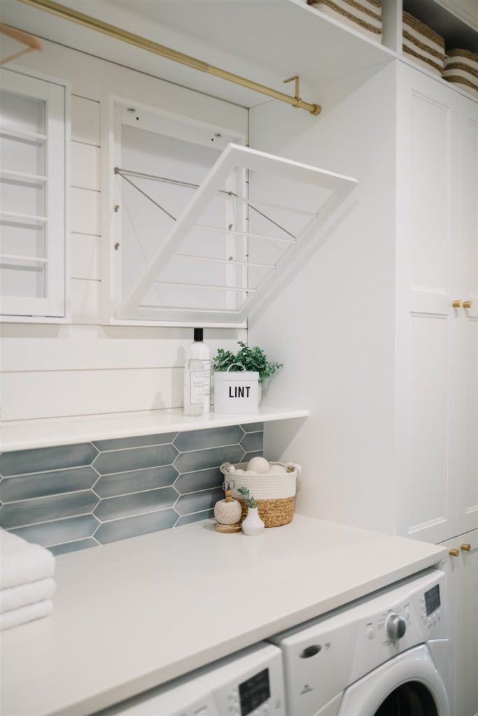 Drying racks above washer and dryer.