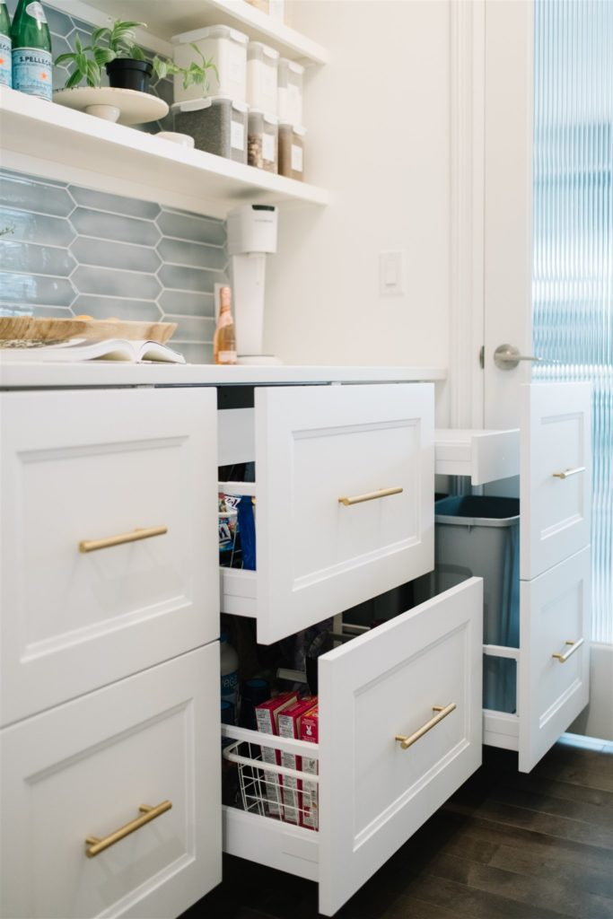 Pantry with pull out drawers and open shelving.