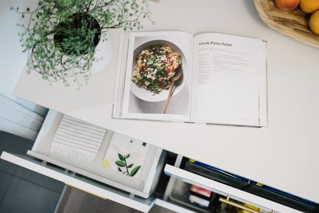 Cook book open on a countertop