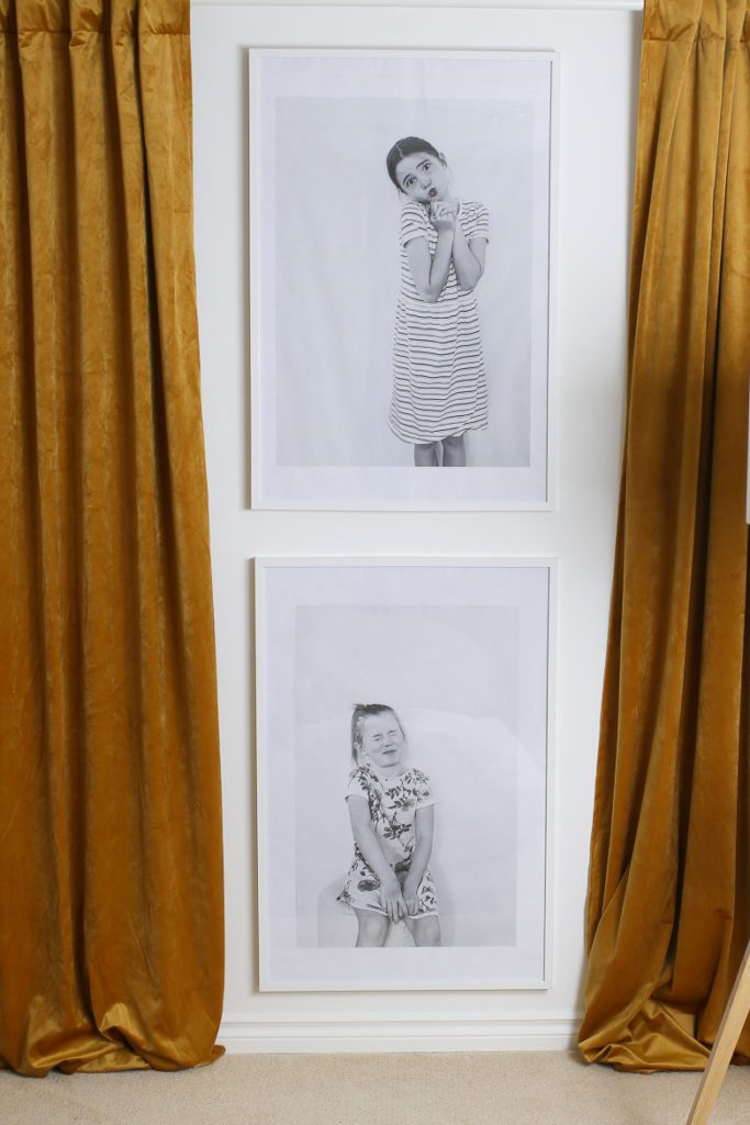 Print large photo portraits of your kids for your family room space.