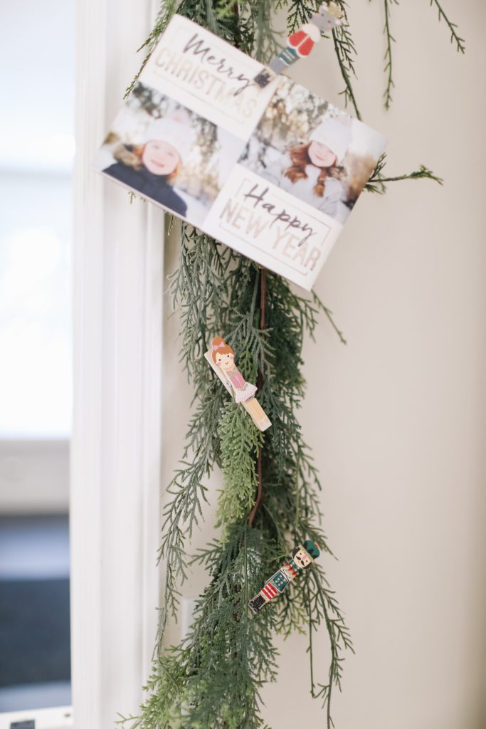 Nutcracker pegs to hold Christmas cards on garland