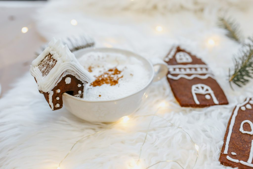 Gingerbread cookies for Christmas. A little mug hugger house and larger flat house shaped gingerbread cookies.