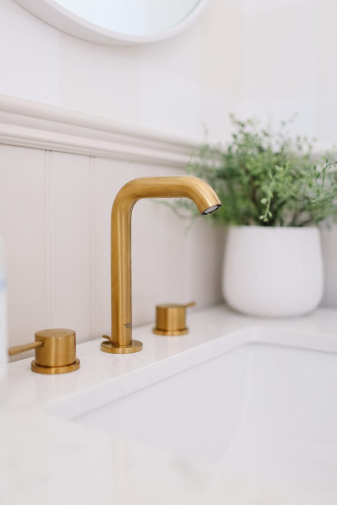 Brass faucet in English country style batrhoom