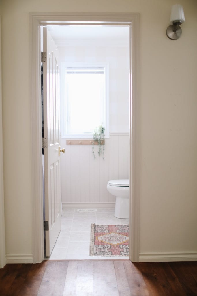 View from the hall of english country style small bathroom refresh