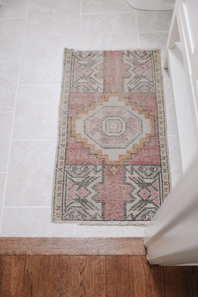 small pink vintage rug in bathroom