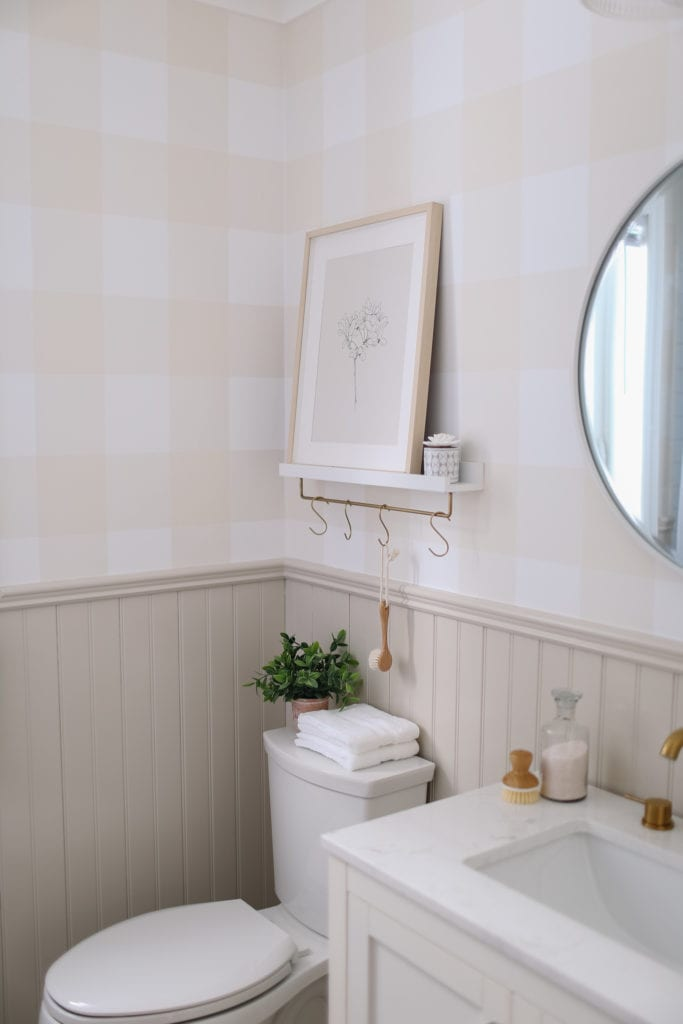 A small bathroom refresh with plaid wallpaper and greige trim