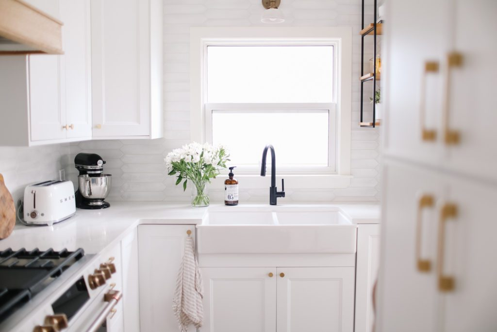 white undermount sink in tiny white kitchen