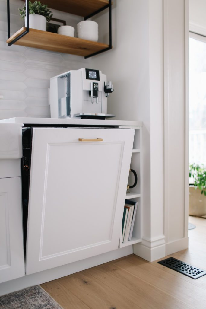 built in dishwasher with ikea axstad panel in tiny white kitchen