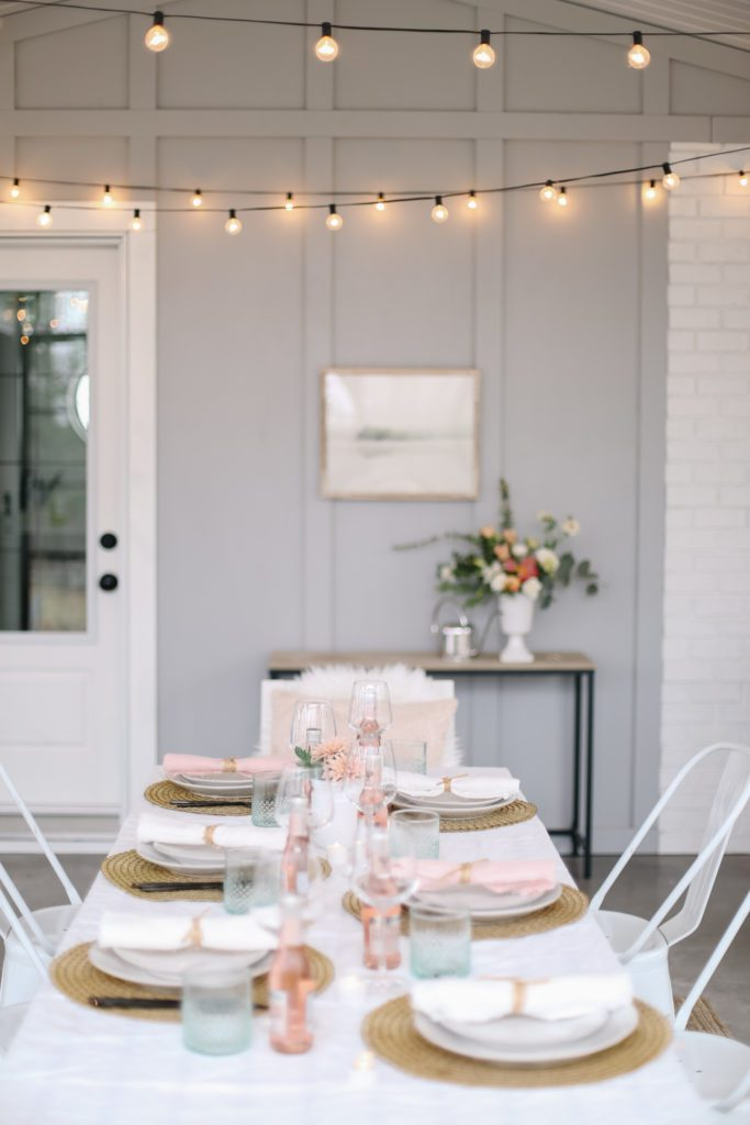 A simple glowing Mother's Day Tablescape with twinkle lights and flowers